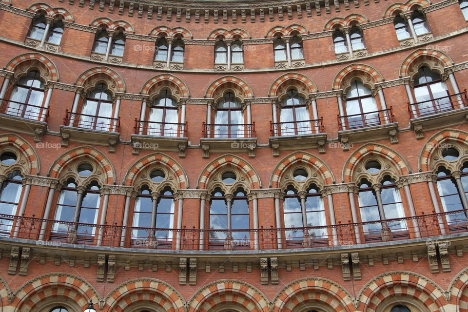 The red brick facade of The St Pancras Renaissance Hotel building in King's Cross, London.