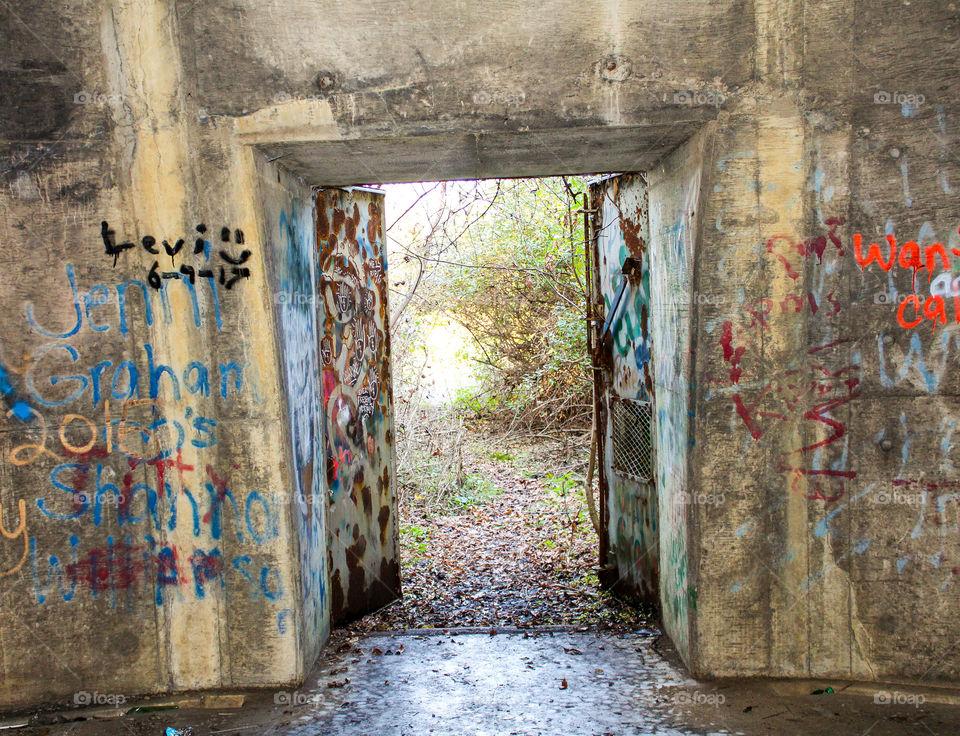 Graffiti and/or vandalism inside concrete storage igloo
