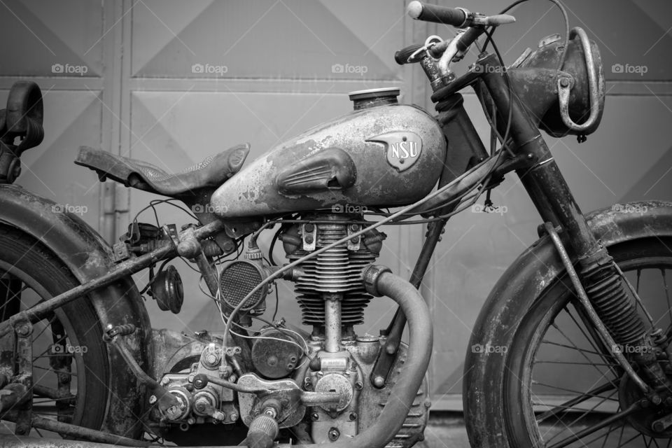old vintage motorcycle NSU OSL 251 from 1951, black and white photo