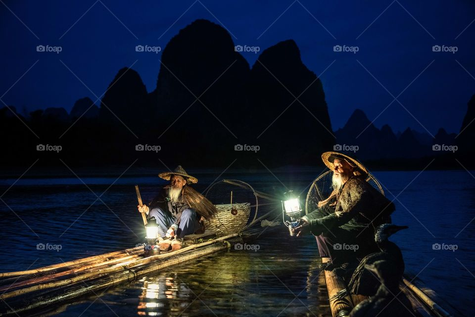 Fisherman fishing at night