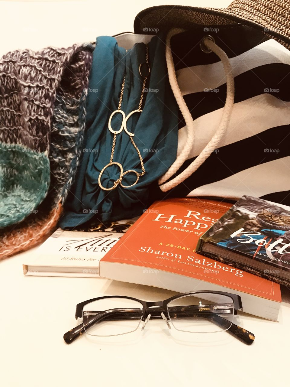Let's get ready to travel with best feel good reads, summer dress, sun hat, glasses, and favorite scarf!