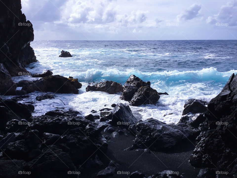Sunny day on the ocean and lava rock
