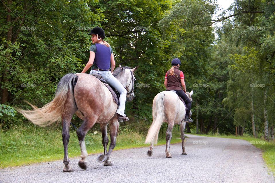 Women riding on horse