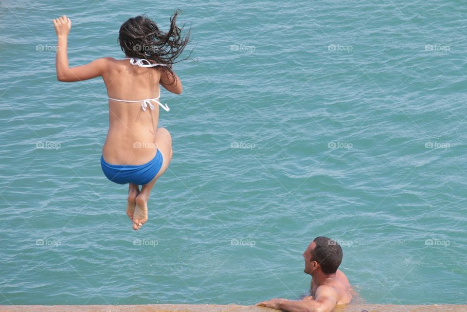 Girl Jumping Into The Water