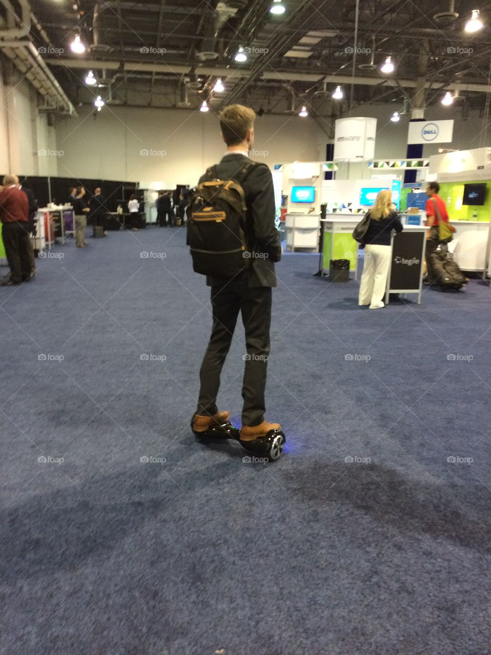 Guy on hover board at conference