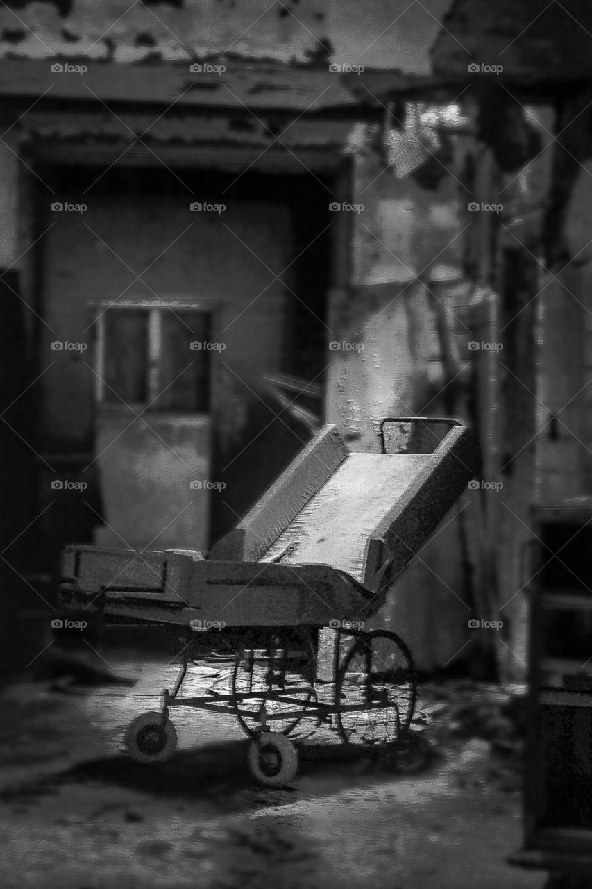 Abandoned hospital bed in a abandon asylum