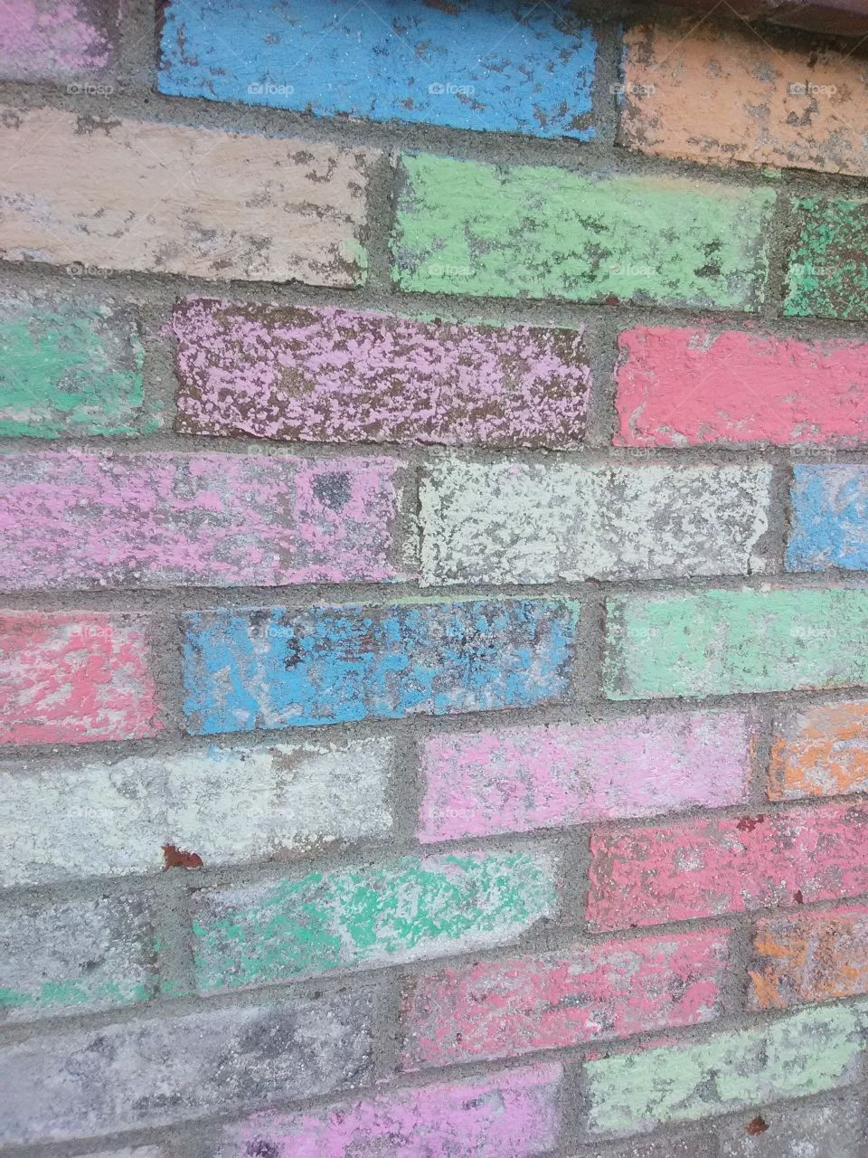 colorful color chalked brick really brighens a place up.