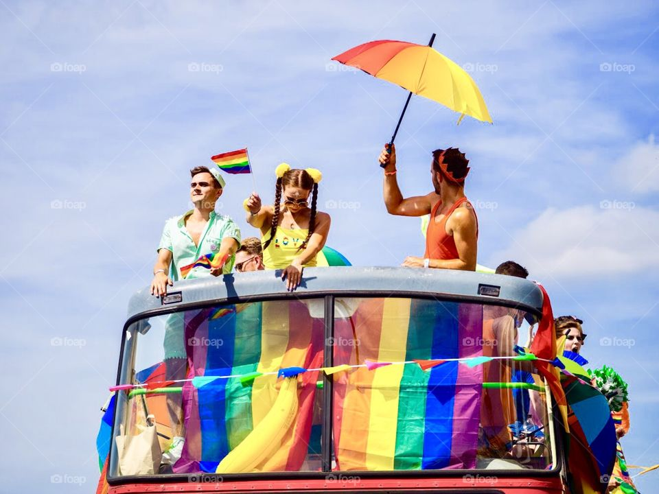 Group on open top vehicle partying during Brighton Pride festival parade