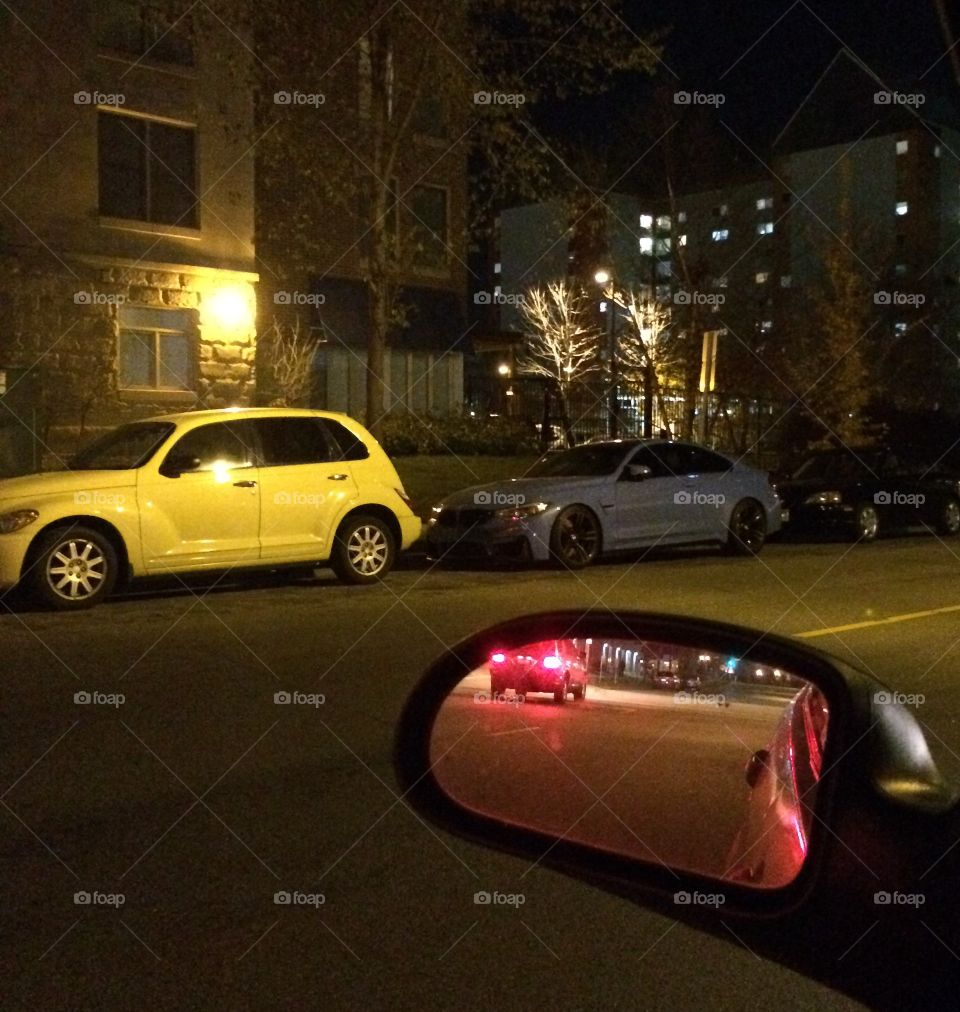 Parked yellow car on street