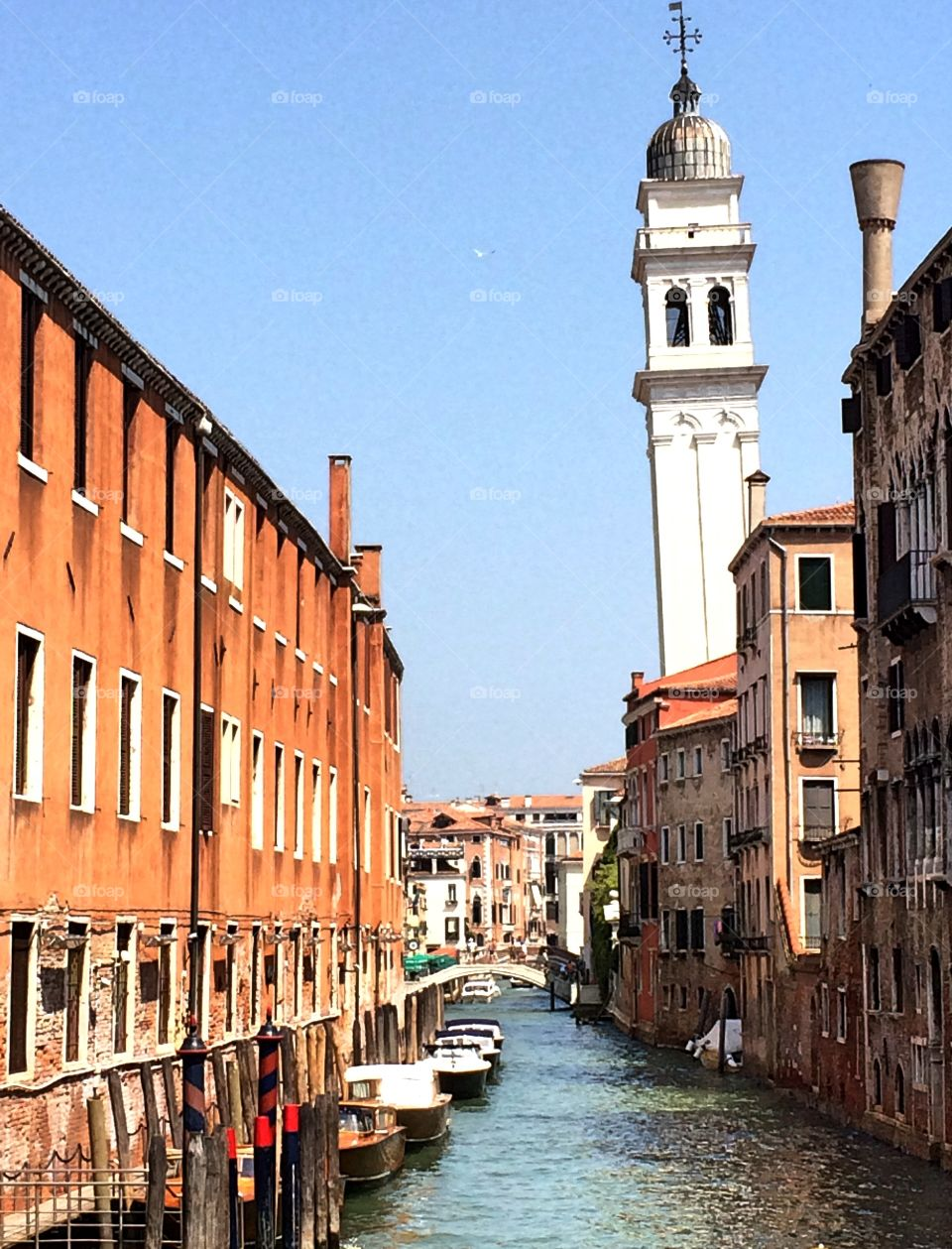 Summer in Venice. View of canal and historic buildings in Venice, Italy