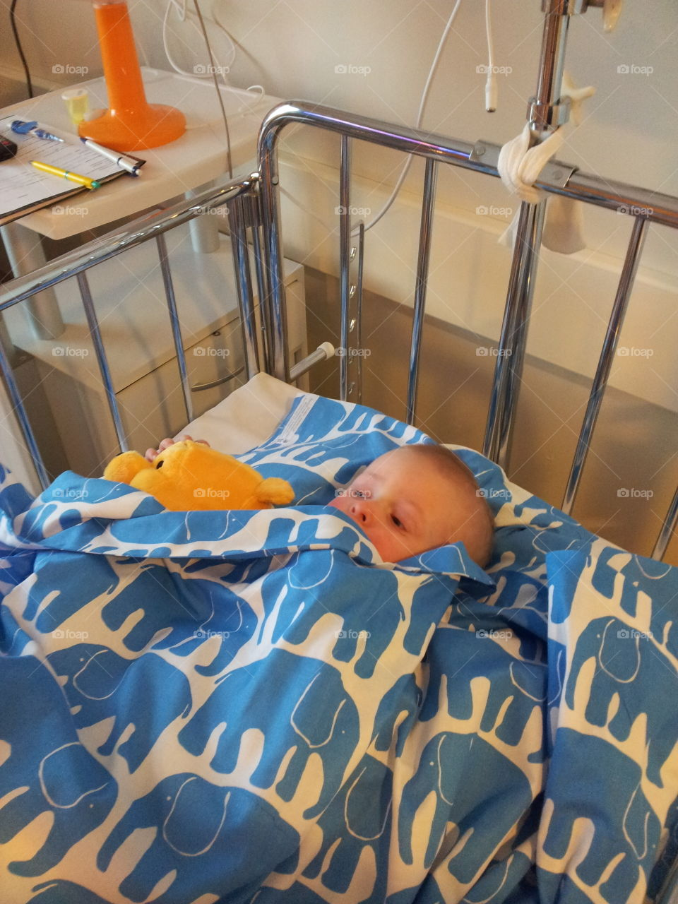 Close-up of boy lying on swing in hospital
