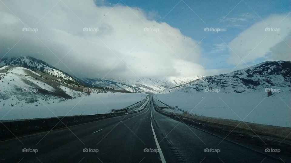 Road through snow covered hills