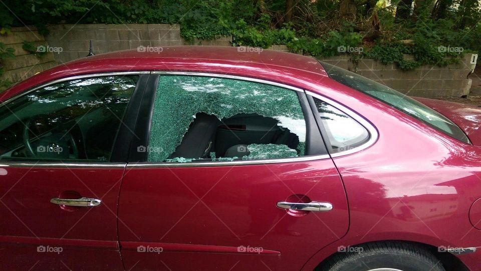 car window. rock thrown through car window