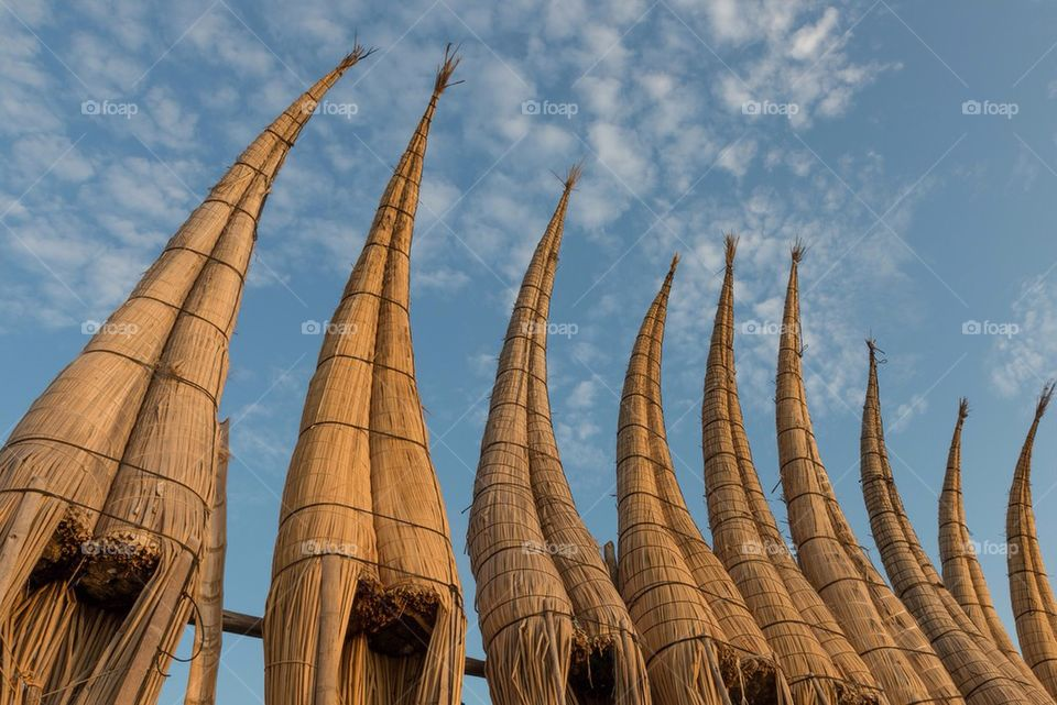 Row of Straw Boats Against Blue Sky, Huanchaco, Peru