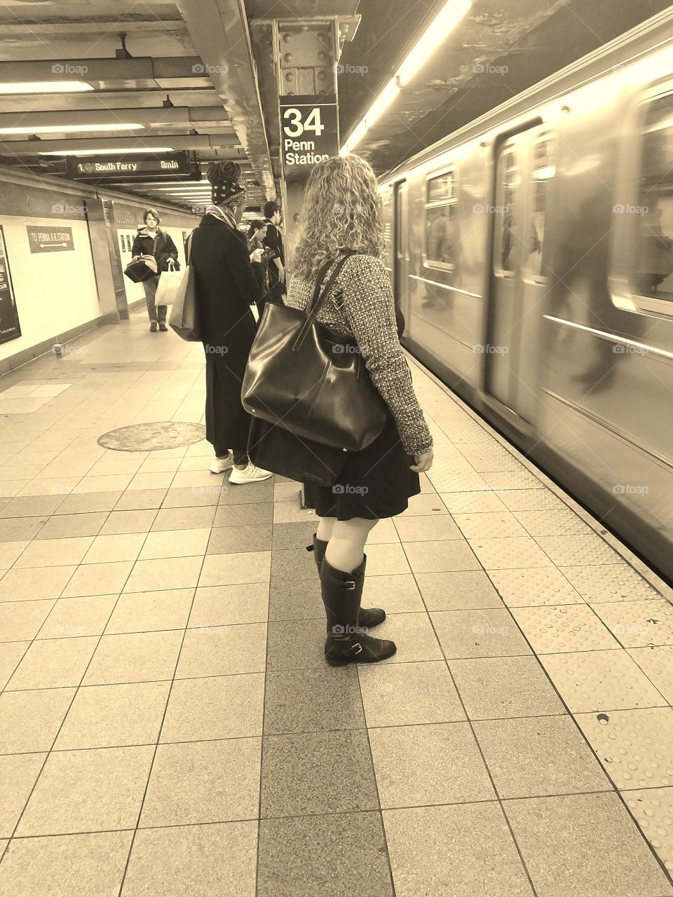 Girl Waiting on Subway Platform in NYC for Train. Sepia Filter. Captured on Android Phone - Galaxy S7. May 2017