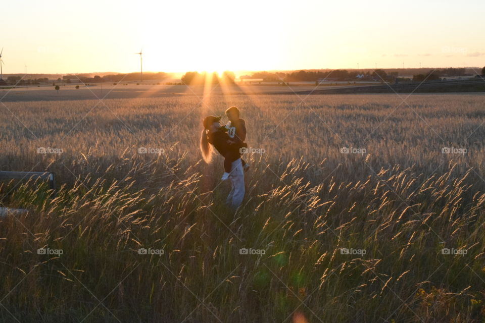 Father carrying his son in field