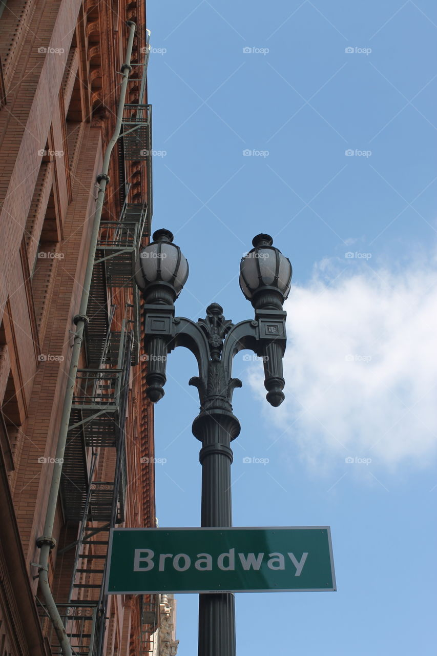 Broadway sign on street lamp