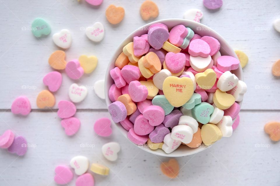 Bowl of Candy Hearts with a message on top
