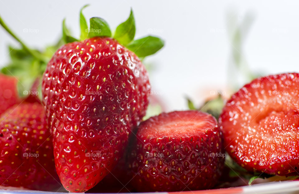 Tasty and delicious red strawberries on the plate white background brillant