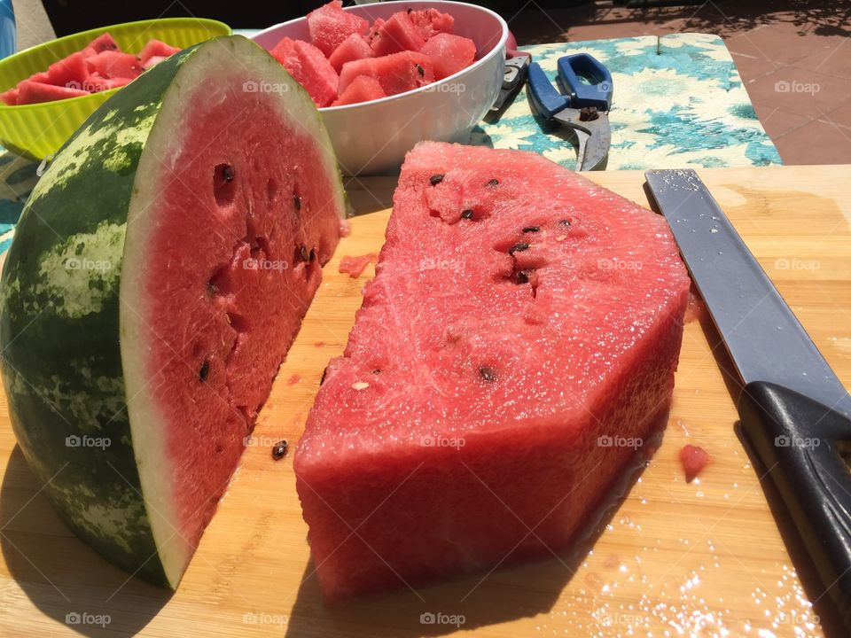 Slice of watermelon ready to eat in a hot and sunny day