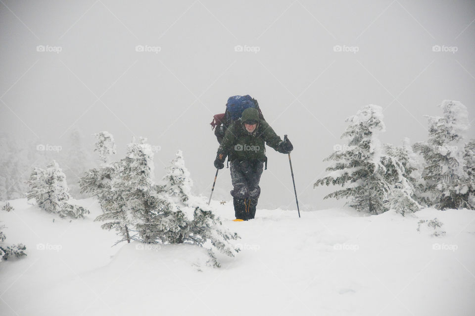 Snowshoeing on a high mountain peak in the winter