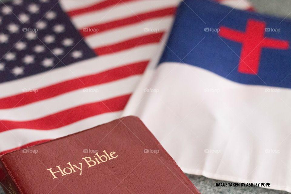 Bible with Christian Flag and American Flag.
