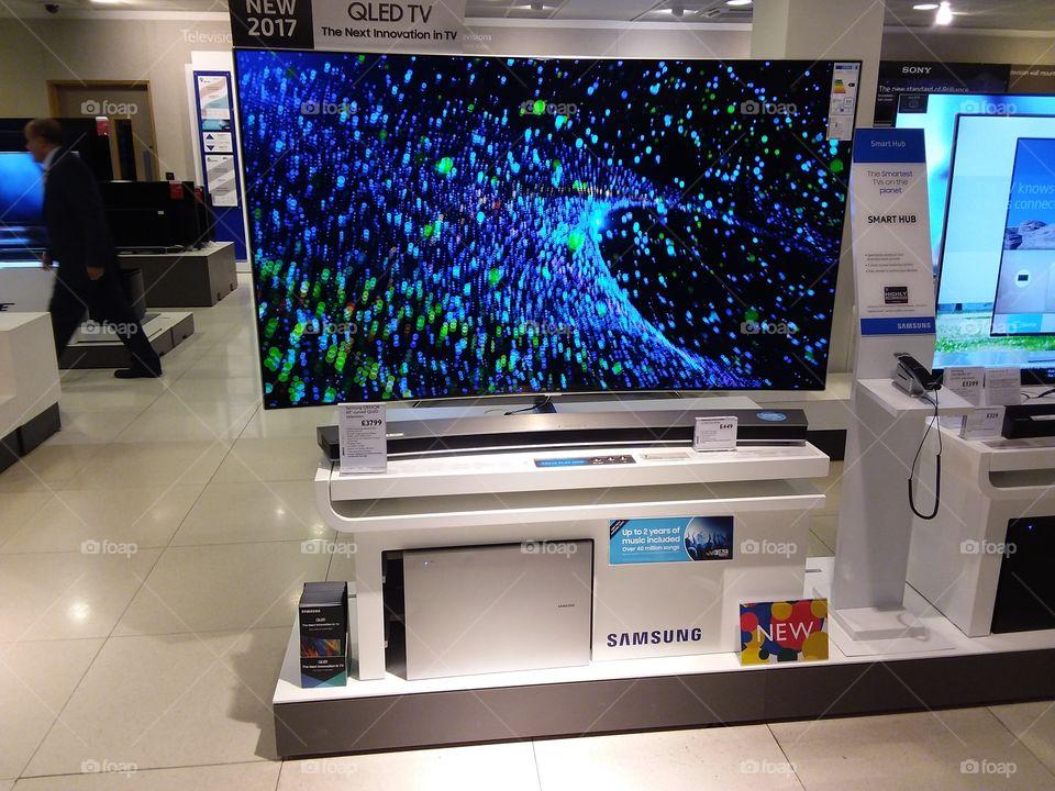 Samsung QLED television 4K Ultra High Definition TV with soundbar and sub-woofer on plinths at Peter Jones Display