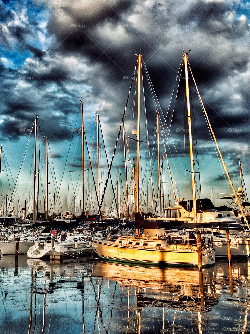 Storm clouds over FL marina.