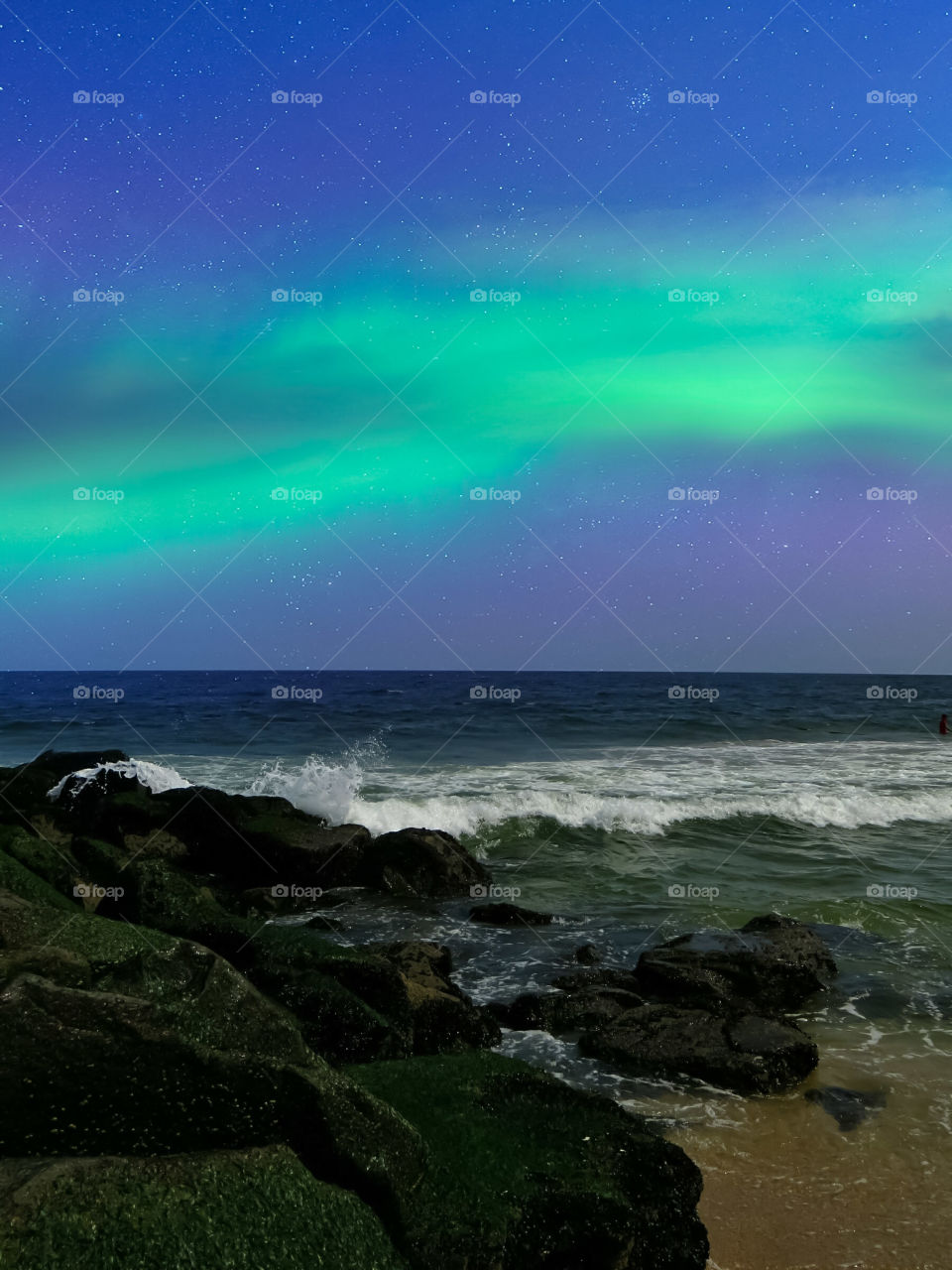 Northern Lights Over The Ocean