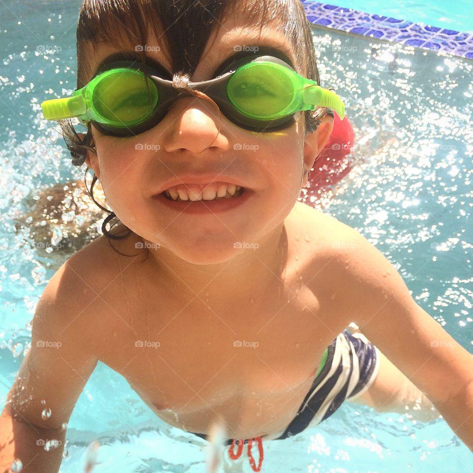Happy boy having fun in swimming pool