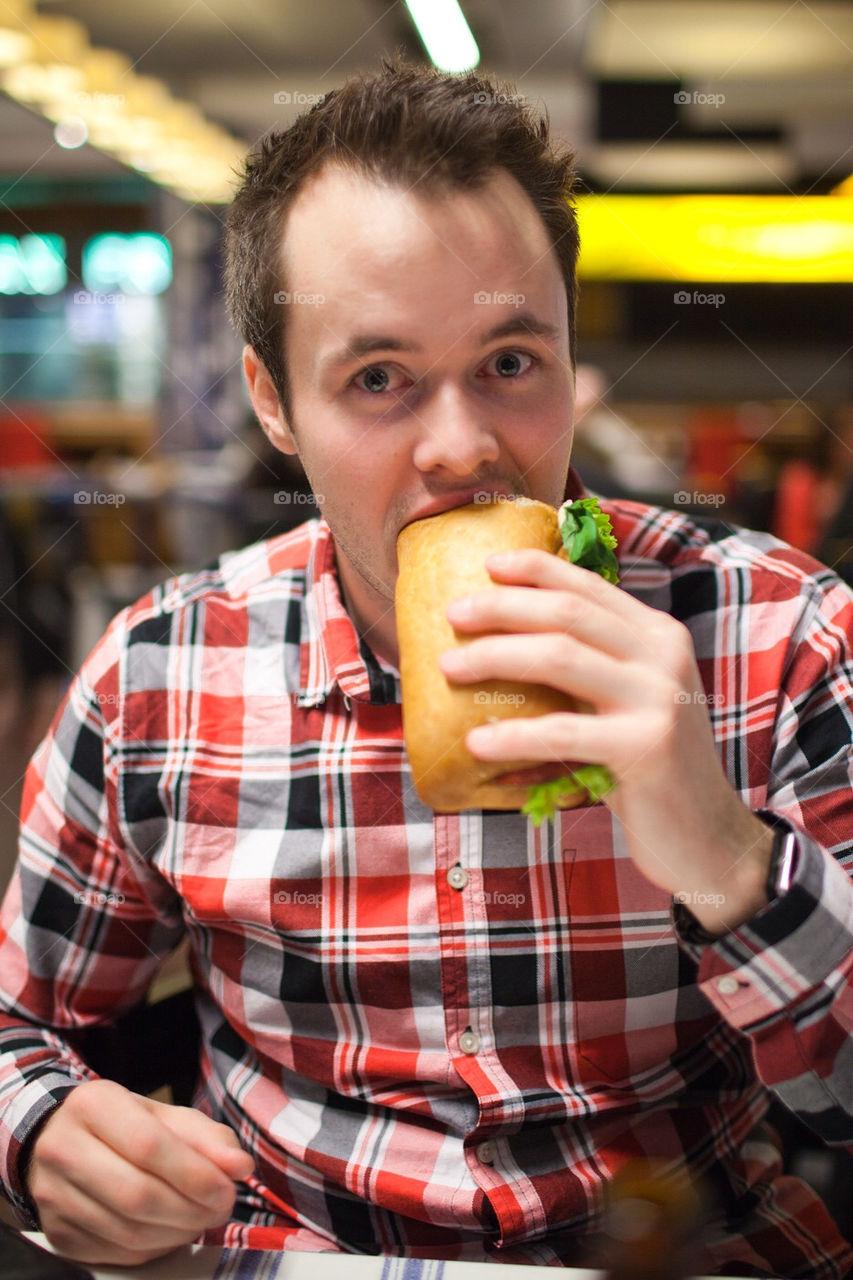 Man eating a sandwich