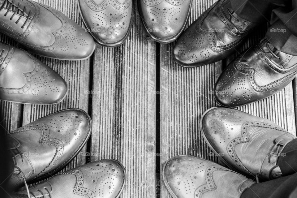 Circle of trust. Shoes in a circle