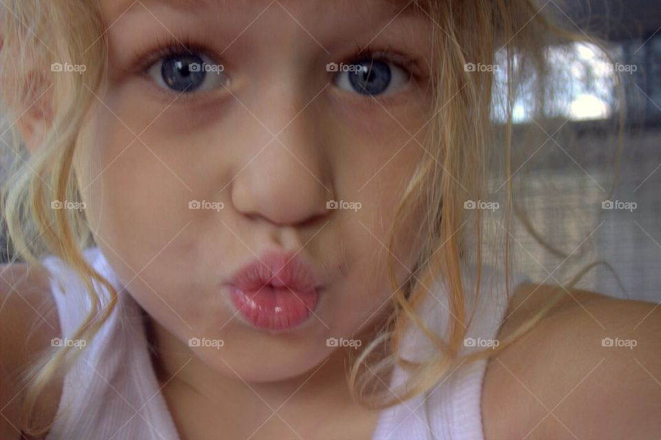 Cute little girl pouting
