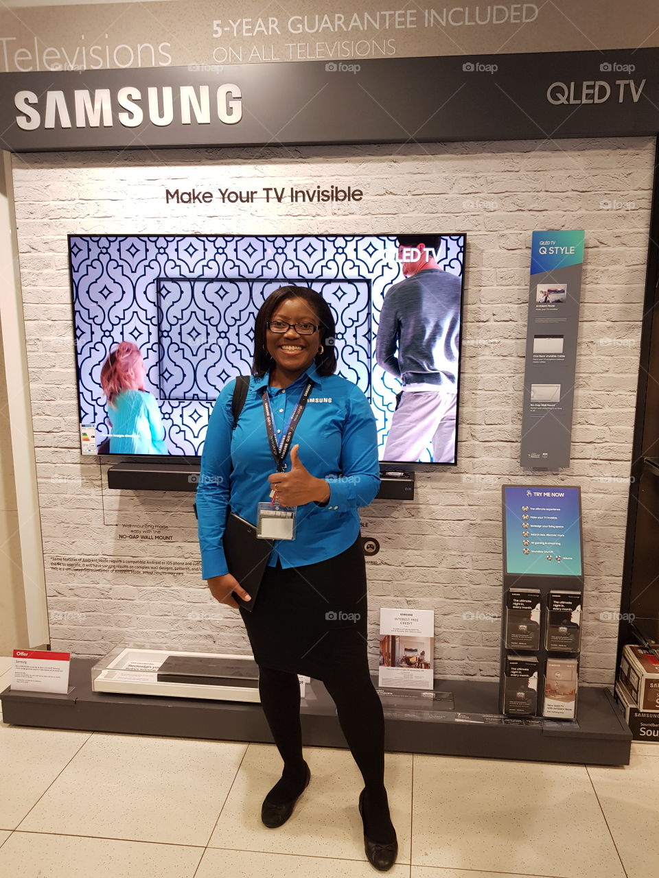 Samsung QLED television with soundbar and field force