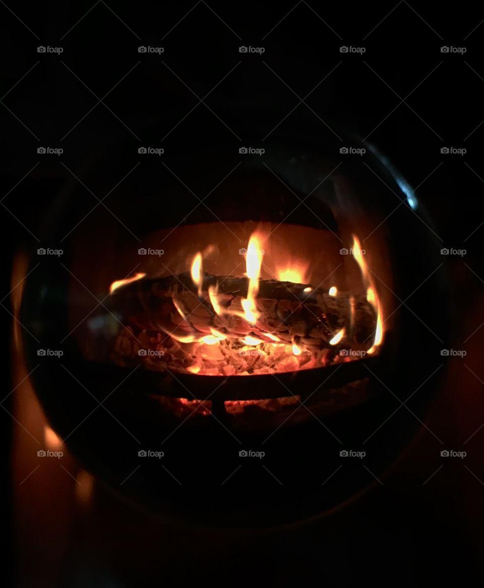 Wood burning stove in lensball