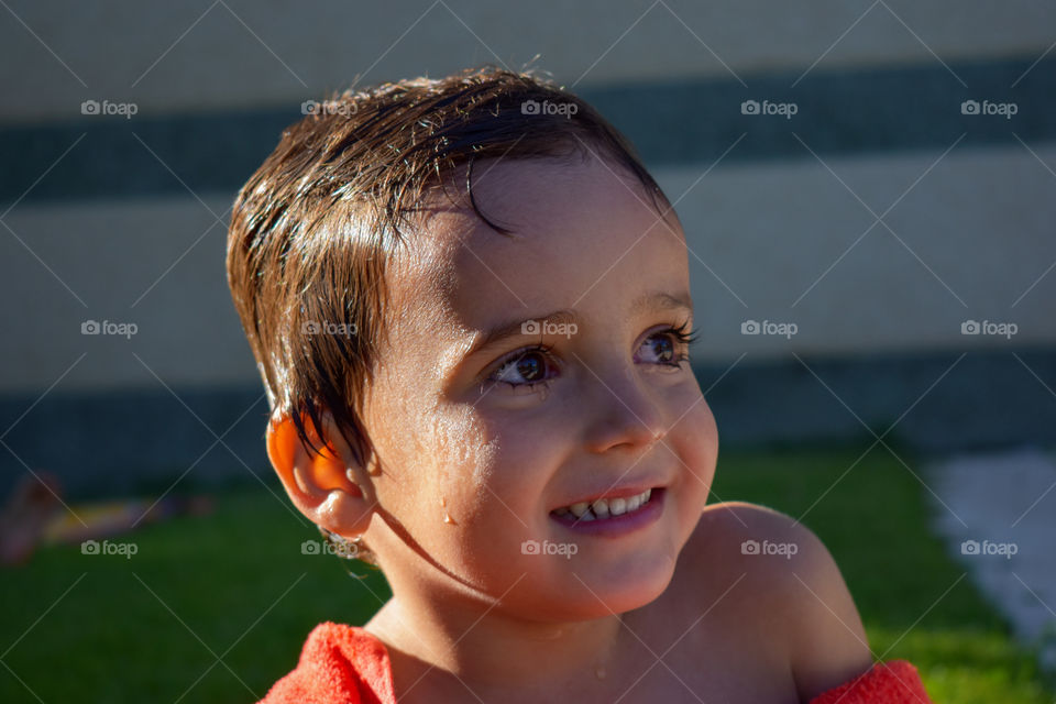 Little child in the swimming pool