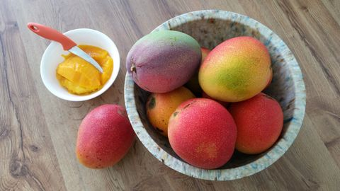 High angle view of ripe mangoes in bowl