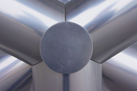 An abstract closeup of an outdoor rotary fan.