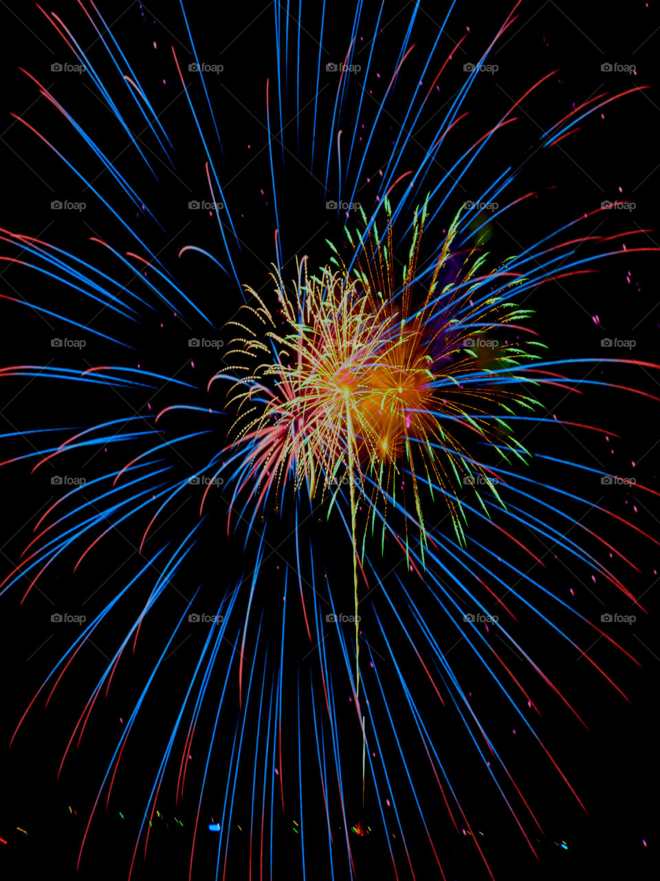 Low angle view of fireworks during night