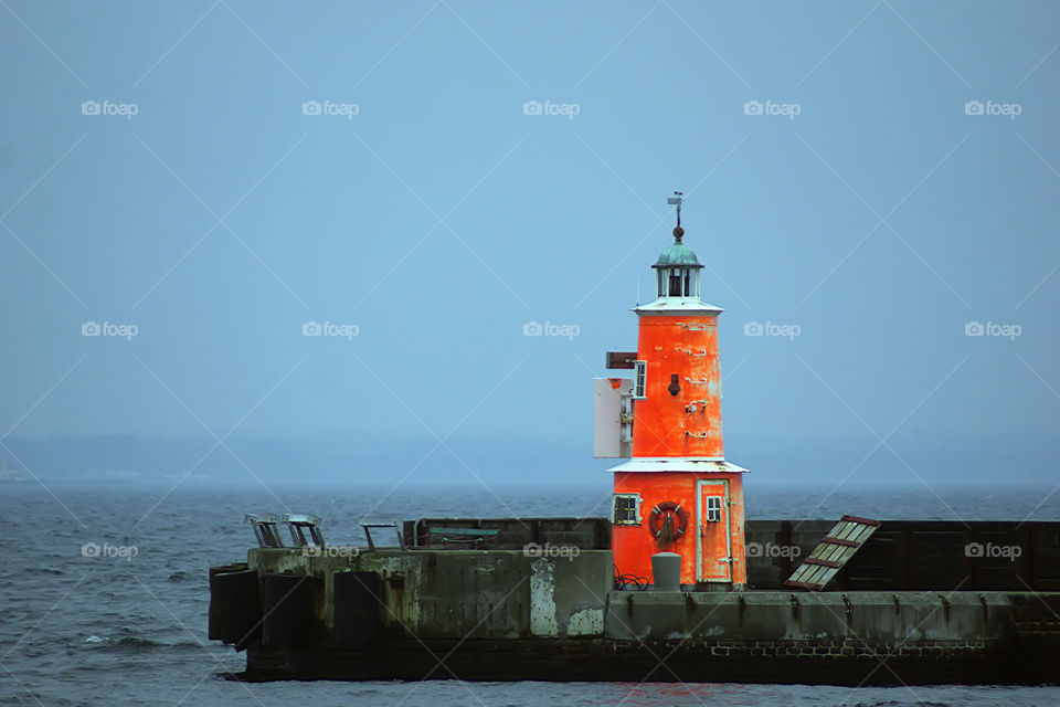 Orange lighthouse on the port, Denmark