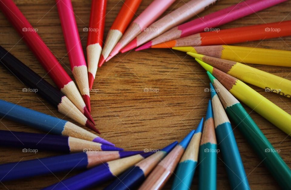 Colorful pencil on wooden table