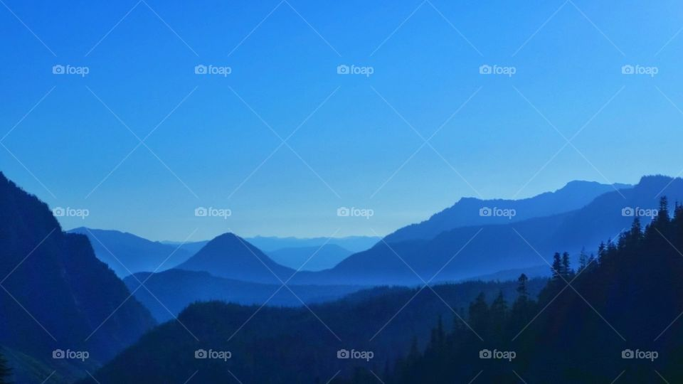 Bold, beautiful and blue sky over mountains, valley, hills, terrains and plateaus during the blue hour.