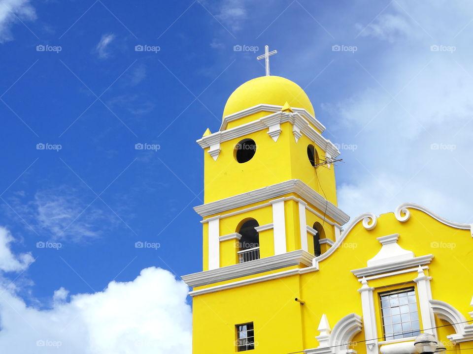 Bright colored church blue sky ayabaca peru