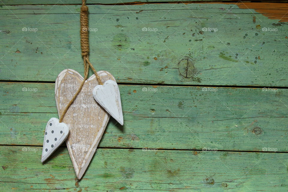 close-up of a wooden heart decorations on a wooden table