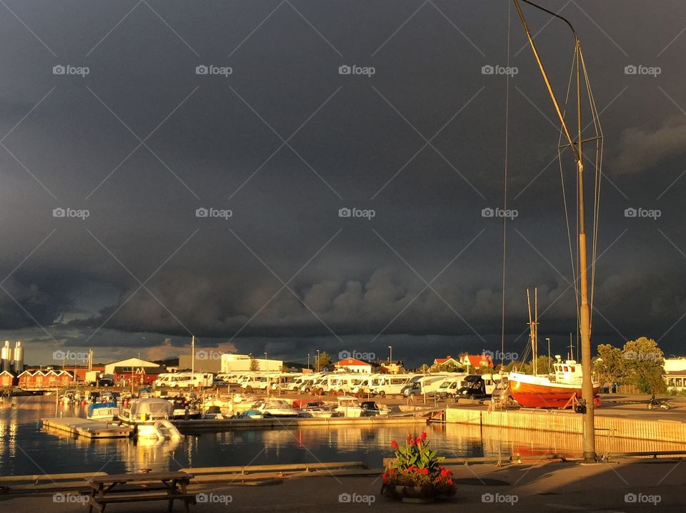 Black sky in the harbour before the storm