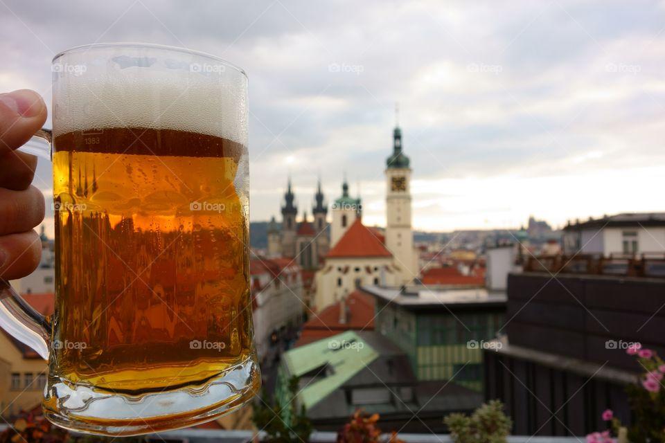 Pint of Czech beer in Prague. A fresh pint of Czech craft beer on a rooftop terrace in the center Prague, Czech Republic.