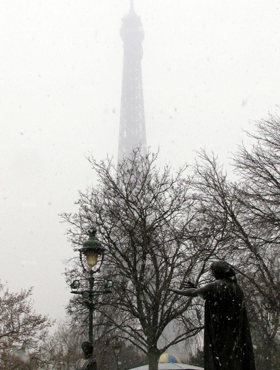 grey Eiffel tower in paris under the snow