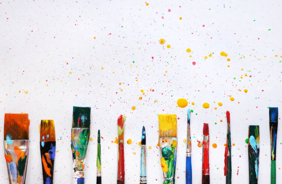 Colorful paint clash, paintbrushes and dots of colors