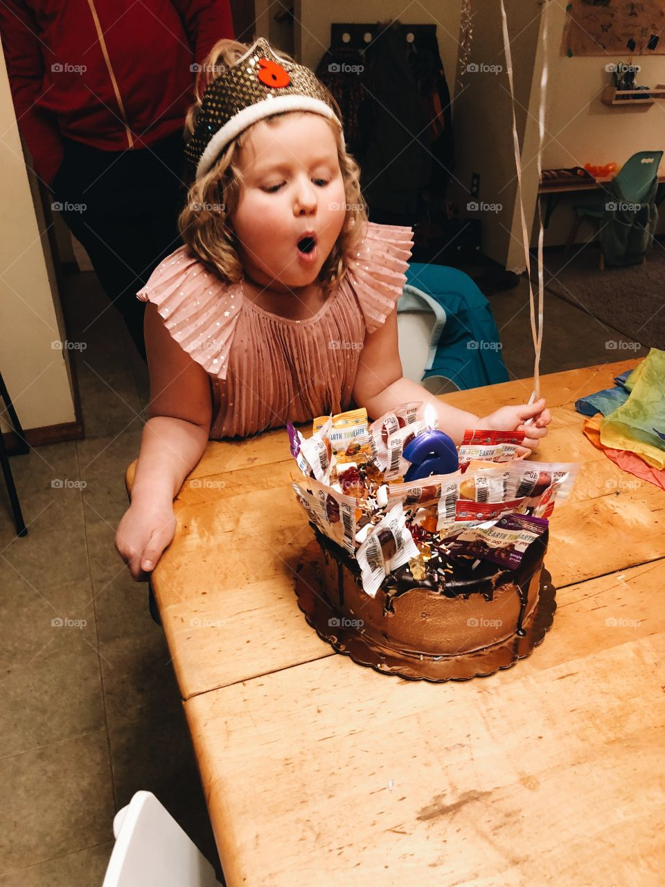 Child Blowing Out Birthday Candles