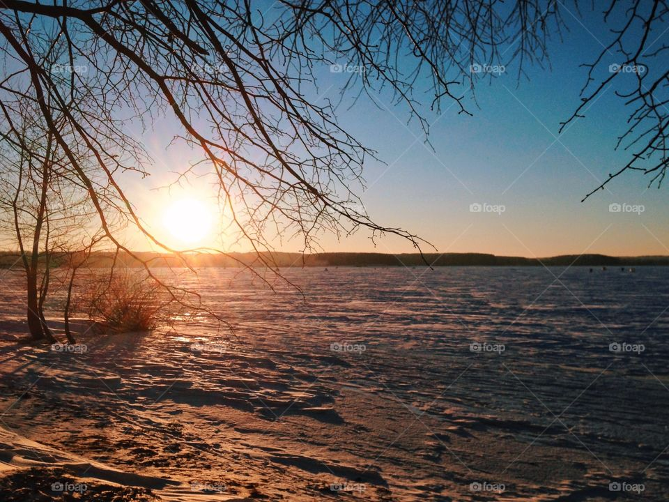 Winter sunset on the frozen lake